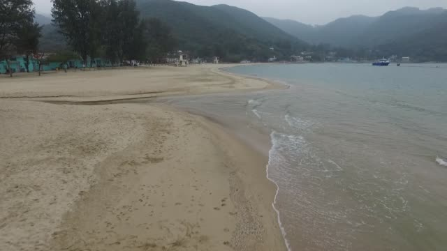aerial view of silvermine bay beach shoreline in mui wo lantau island hong kong no - lantau stock videos and b-roll footage