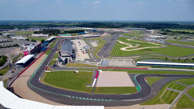 aerial view of silverstone circuit. tracking in. - curve stock videos & royalty-free footage