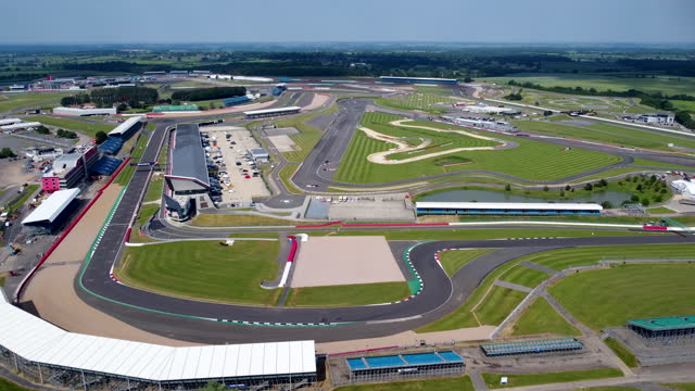 aerial view of silverstone circuit. tracking l to r. - curve stock videos & royalty-free footage