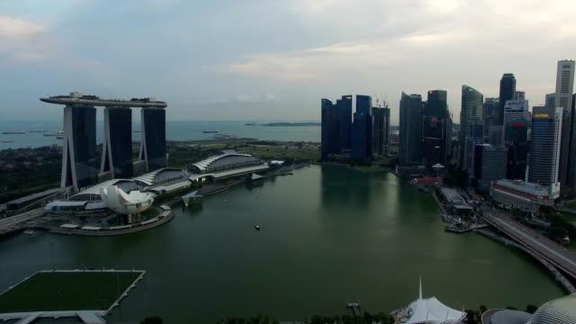 aerial view of singapore marina bay and marina bay sands - marina bay sands stock videos and b-roll footage