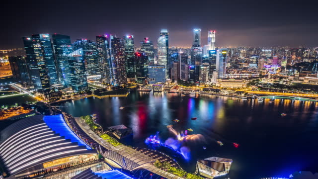 t/l ws ha zo aerial view of singapore skyline at night / singapore - singapore stock videos & royalty-free footage