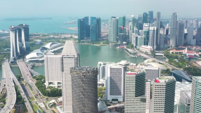 vídeos de stock e filmes b-roll de aerial view of singapore  with financial district buildings,hotels,tourist attractions.travel destination in asia - singapura