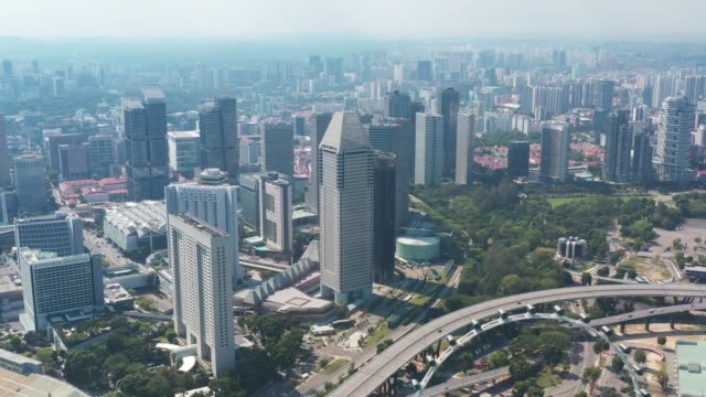 aerial view of singapore  with financial district buildings,hotels,tourist attractions.travel destination in asia - singapore stock videos & royalty-free footage