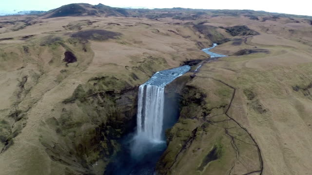 aerial view of skogafoss waterfall in iceland - terra brulla video stock e b–roll