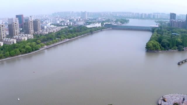 stockvideo's en b-roll-footage met aerial view of skyline and modern buildings in ningbo at riverbank - ningbo