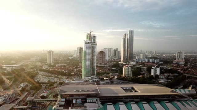 aerial view of skyscrapers and a highway during sunset in downtown johor bahru malaysia - johor stock videos & royalty-free footage