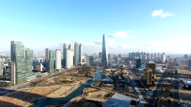 aerial view of skyscrapers and developing area in songdo new town - personal land vehicle stock videos & royalty-free footage