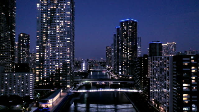 aerial view of skyscrapers at night - travel destinations stock videos & royalty-free footage