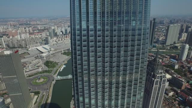 vidéos et rushes de aerial view of skyscrapers in downtown district of tianjin - plein
