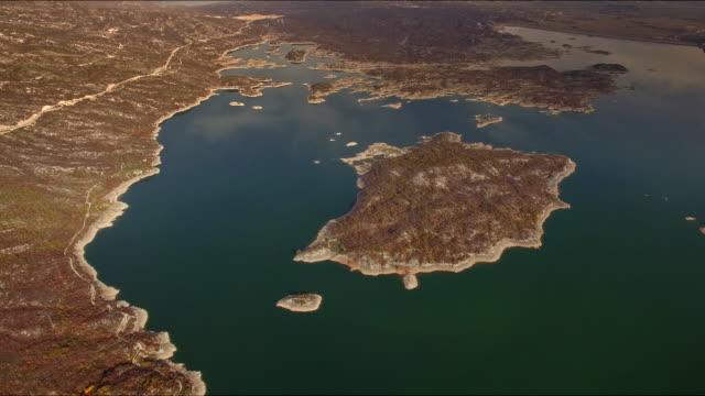 aerial view of slano jezero with coastline 4k - montenegro stock videos & royalty-free footage
