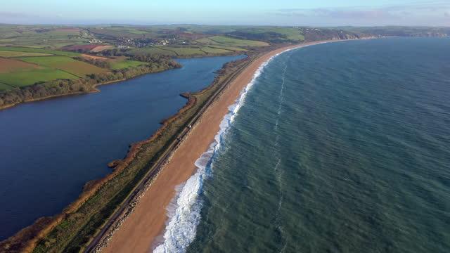 vídeos y material grabado en eventos de stock de aerial view of slapton sands, devon, england - devon