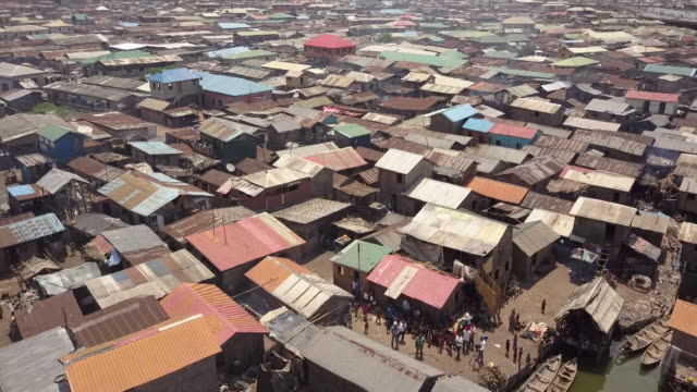 aerial view of slum houses on the outskirts of lagos nigeria - nigeria stock videos and b-roll footage