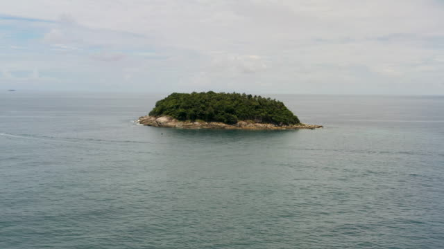 aerial view of small island in the middle of the sea - small stock videos & royalty-free footage