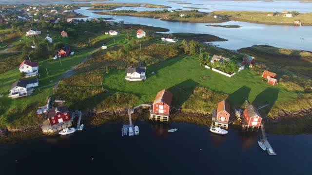 vídeos y material grabado en eventos de stock de aerial view of small islands with small fishing village, norway - casita de campo