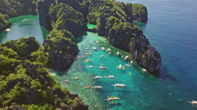 aerial view of small lagoon in palawan, philippines - filippine video stock e b–roll