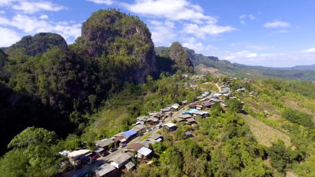 aerial view of small village on the mountain in the morning - remote location stock videos & royalty-free footage