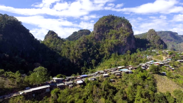 aerial view of small village on the mountain with beautiful peak in the morning - remote location stock videos and b-roll footage