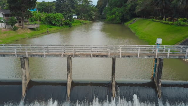 aerial view of small water's gate or weir of irrigation in countryside - sea channel stock videos and b-roll footage