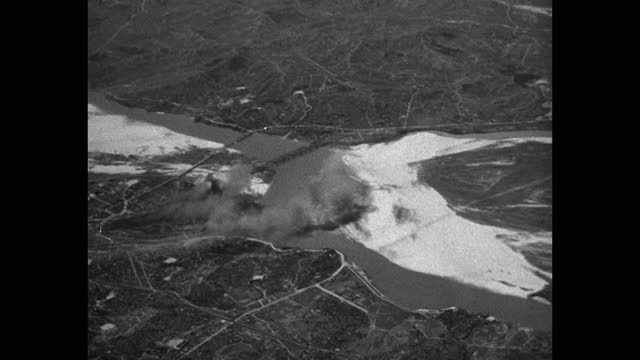aerial view of smoke after bomb explosion in city, korean war korea - aircraft point of view stock videos & royalty-free footage