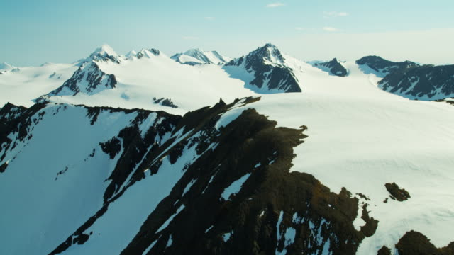 aerial view of snow covered mountain peaks alaska - eco tourism video stock e b–roll
