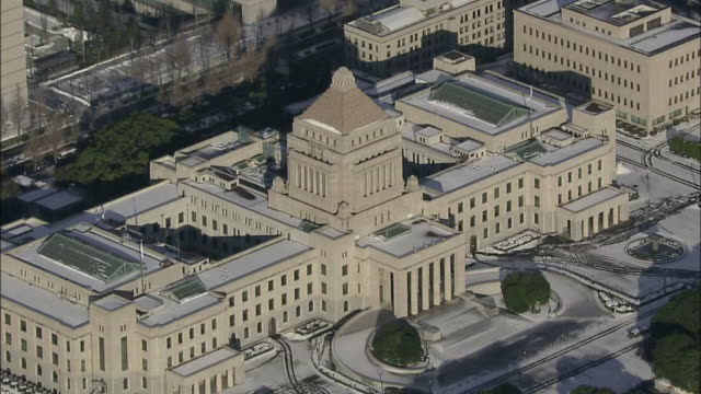 aerial view of snow covered tokyo with the national diet building. - 国会議事堂点の映像素材/bロール