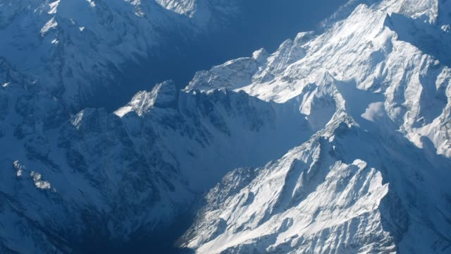aerial view of snow peak mountain range in winter - ridge stock videos & royalty-free footage