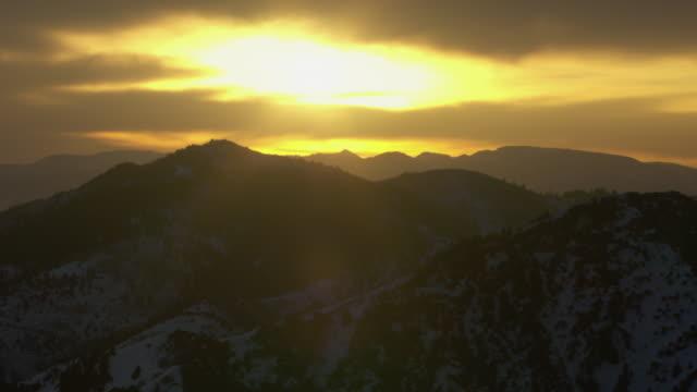 aerial view of snowcapped wasatch range during sunrise in utah, united states of america. - utah stock videos & royalty-free footage