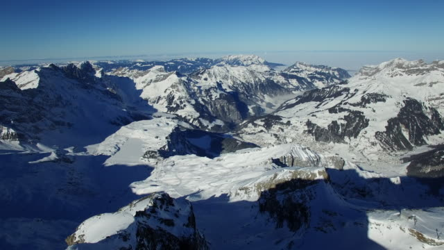 Aerial View of snowy Landscape with Ski Resort for Winter Sport