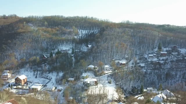 aerial view of snowy mountain village - pinaceae stock videos & royalty-free footage