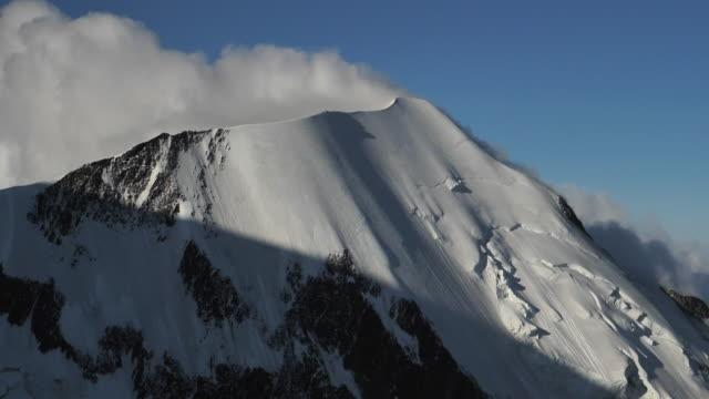 aerial view of snowy mountains - mountain ridge stock videos & royalty-free footage