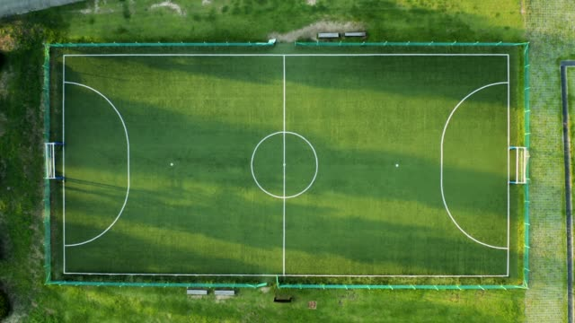 aerial view of soccer field during sunset - football pitch stock videos & royalty-free footage