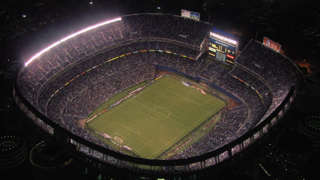 vídeos de stock e filmes b-roll de aerial view of soccer game in qualcomm stadium at night, san diego, california, united states of america - football