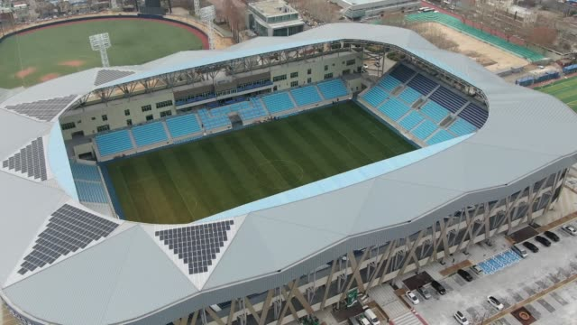 aerial view of soccer stadium in daegu, south korea - daegu stock videos and b-roll footage