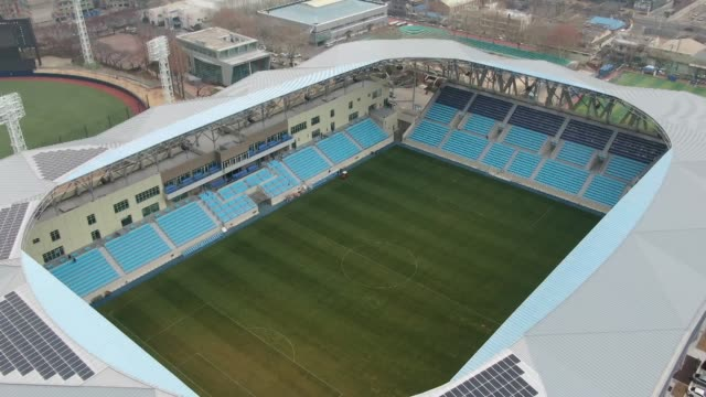 aerial view of soccer stadium in daegu, south korea - lawn stock videos & royalty-free footage