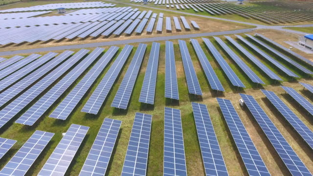 aerial view of solar farm with sunlight, renewable energy, solar energy - electrical equipment stock videos & royalty-free footage