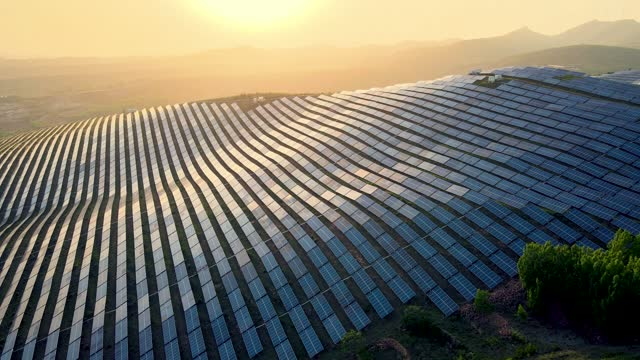 aerial view of solar panels in mountain - sustainable resources stock videos & royalty-free footage