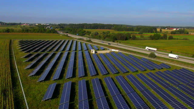 ws aerial view of solar power station and highway - solar panels stock videos & royalty-free footage