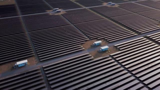 aerial view of solar power station farm alternative energy - solar energy stock videos & royalty-free footage