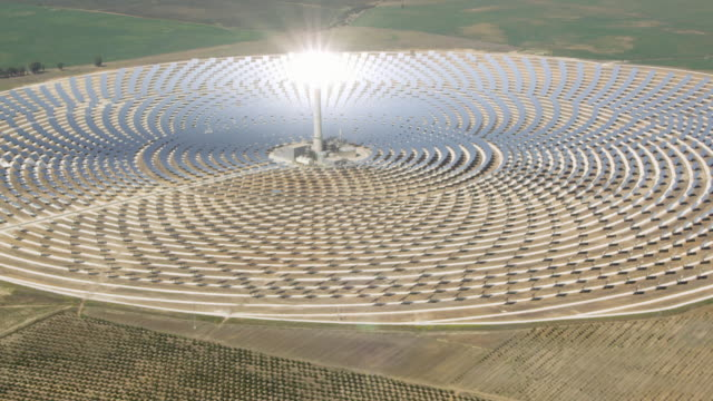 aerial view of solar-thermal power plant - power station stock videos & royalty-free footage