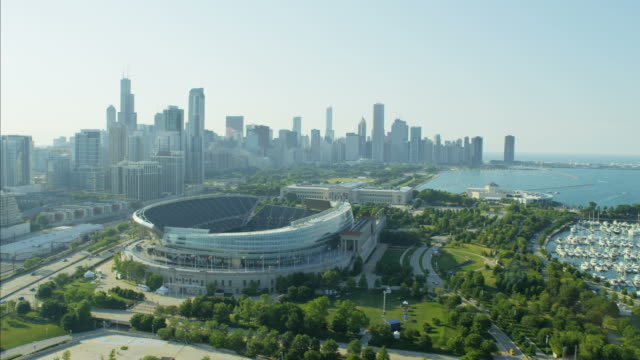 aerial view of soldier field football stadium chicago - panning stock videos & royalty-free footage