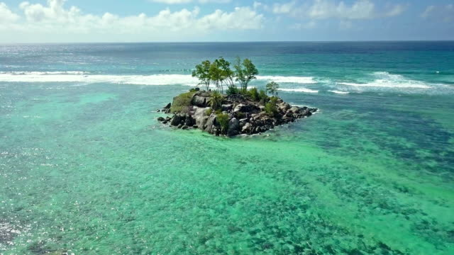aerial view of souris island - anse royale - mahe - clima tropicale video stock e b–roll