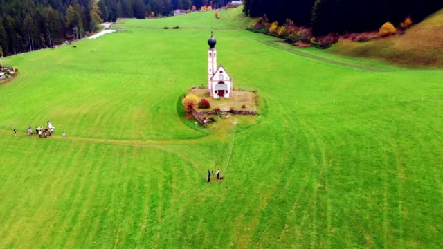 aerial view of st johann church in val di funes / south tyrol - italy - north tirol stock videos & royalty-free footage