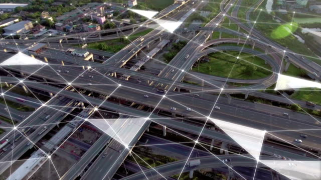 aerial view of stacked highway junction with futuristic network - thoroughfare stock videos & royalty-free footage