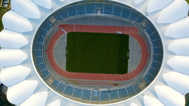 aerial view of stadium - grass family stock videos & royalty-free footage