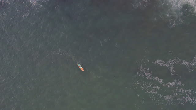 aerial view of stand up paddle boarder on open sea - using a paddle stock videos & royalty-free footage