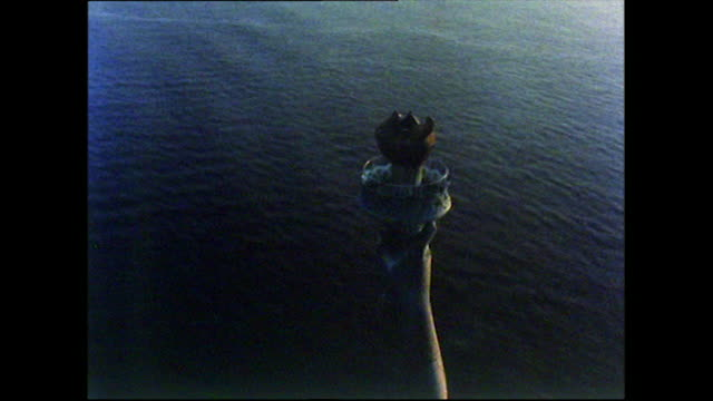 aerial view of statue of liberty at sunset; 1972 - female likeness stock videos & royalty-free footage