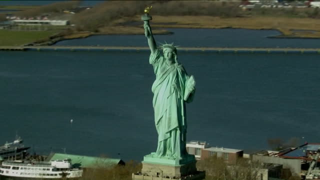 wpix aerial view of statue of liberty - statue of liberty new york city stock videos & royalty-free footage