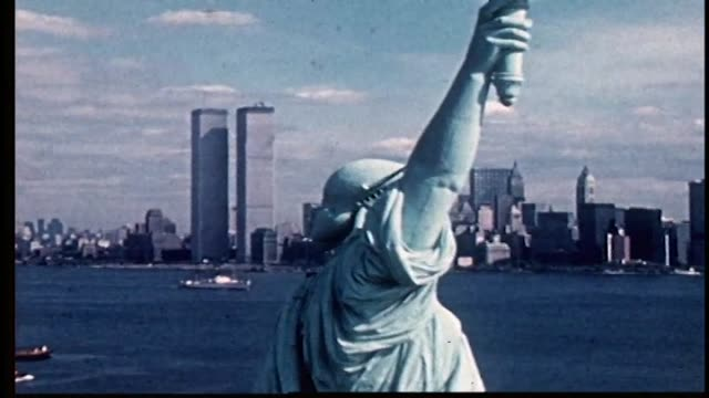 stockvideo's en b-roll-footage met aerial view of statue of liberty with ny harbor and lower manhattan with the world trade center in the background. - prelinger archief