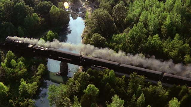 aerial view of steam train traveling over bridge / arkansas - historical reenactment stock videos & royalty-free footage
