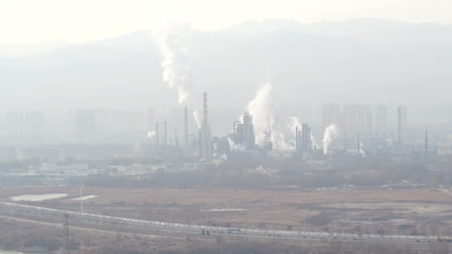 aerial view of steel mill and air pollution in lanzhou, china - 大気汚染点の映像素材/bロール